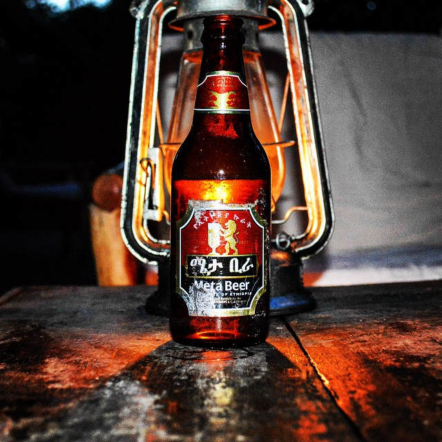 Happy Friday! Find yourself a tree bar, lantern and cold drink to celebrate. #travel #beer #africa